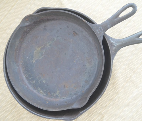 Cast iron skillets in dire need of attention.